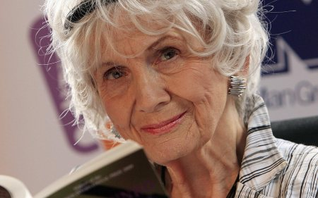 Canadian author Alice Munro holds one of